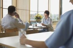 Doctors on Work Break In Cafeteria Royalty Free Stock Image