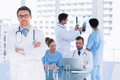 Doctors at work in medical office Stock Photos