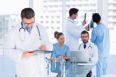 Doctors at work in medical office Stock Photo