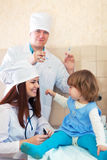 Doctors working with baby Stock Photos