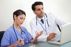 Doctors working with a laptop Royalty Free Stock Photography