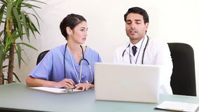 Doctors working with a laptop stock video