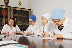 Doctors working with papers Stock Photo