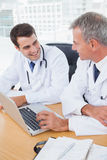 Doctors working together on laptop Royalty Free Stock Photography
