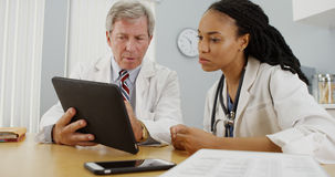 Doctors working together in the office Stock Photography