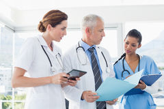 Doctors working together on patients file Royalty Free Stock Photos