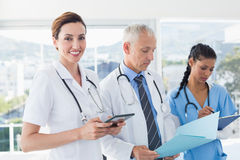 Doctors working together on patients file Stock Photography