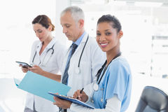 Doctors working together on patients file Royalty Free Stock Photography