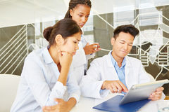 Doctors working together with tablet Stock Images