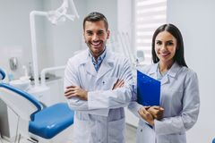 Doctors at workplace in dental clinic stock photography