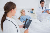 Doctors with xray and digital tablet Royalty Free Stock Photo