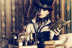Doctrine. Portrait of a beautiful steampunk woman over vintage background Royalty Free Stock Photos