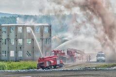 Doctrine van brandbestrijders en ziekenwagenteam stock afbeeldingen