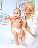 Doctror pediatrician and baby. First steps Royalty Free Stock Photos