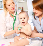 Doctror pediatrician and baby and mother Stock Photography