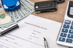 Documant, dollar, pen, calculator and toy car. With keys Stock Photography