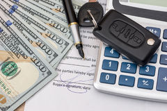 Documant, dollar, pen, calculator and toy car. With keys Royalty Free Stock Photo