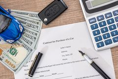 Documant, dollar, pen, calculator and toy car Stock Image