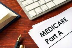 Document avec la partie A d'assurance-maladie de titre photographie stock