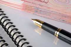 Document, banknote and fountain pen Royalty Free Stock Images