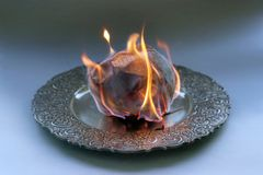 Document burning in vintage plate. Royalty Free Stock Image