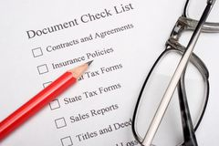 Document Check List. Red pencil and glasses on a document check list Stock Image