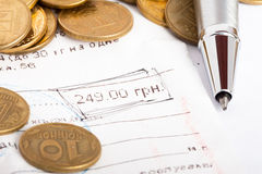 Document with circled number and coins Stock Photo