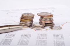 Document with coins Royalty Free Stock Photography