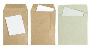 Document d'enveloppe de Brown avec le papier d'isolement sur le fond blanc Photographie stock libre de droits