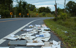 Document discard on road . Royalty Free Stock Photography
