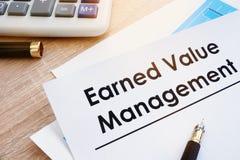 Document Earned Value Management on a desk. Document Earned Value Management on an office desk Stock Photos