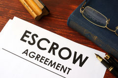 Document escrow agreement. Document with title escrow agreement stock photo