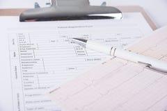 Document file with patient registration form and cardiogram. Image of Document file with patient registration form and cardiogram stock image