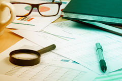 Document financial with magnifying glass Royalty Free Stock Photography