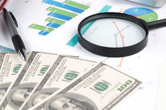 Document financial with magnifying glass Stock Photos
