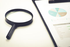 Document financial with magnifying glass.searching profit Stock Image