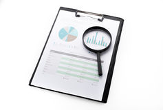 Document financial with magnifying glass.searching profit Stock Photos
