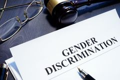 Document about Gender Discrimination and gavel stock photography