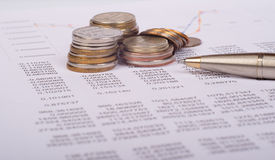 Document with graphs and coins Stock Photo