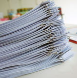 Document and handout. Handouts were arranged in a series, stacked on table outside meeting room stock photo
