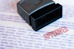 Document that has been stamped printed on Approved in large diagonal red text and rubber stamp, Business credit concept.  royalty free stock image