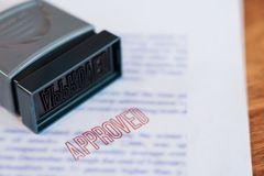 Document that has been stamped printed on Approved in large diagonal red text and rubber stamp, Business credit concept stock photo