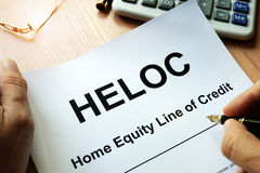 Document HELOC Home equity line of credit. Document HELOC Home equity line of credit on a table Stock Photography