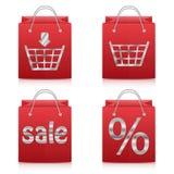 Document het winkelen zakken in rood op witte achtergrond Royalty-vrije Stock Foto's