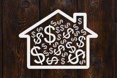 Document huis met binnen dollars Conceptueel beeld Stock Foto