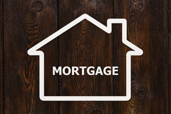 Document huis met hypotheek binnen woord Conceptueel beeld Stock Fotografie