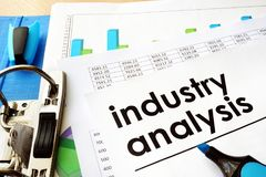 Document industry analysis in a folder. Document industry analysis in an office folder Stock Images