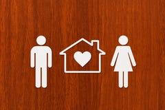 Document man, vrouw en huis Huisvesting, familieconcept Abstracte conceptueel Stock Foto's