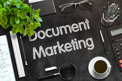 Document Marketing on Black Chalkboard. 3D Rendering. Stock Photography