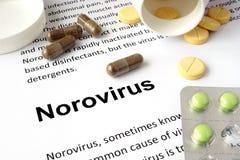 Document met norovirus en pillen royalty-vrije stock foto's